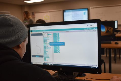 Senior Zach Mann practices coding in his computer science course.  Many students will use these skills in the work force.