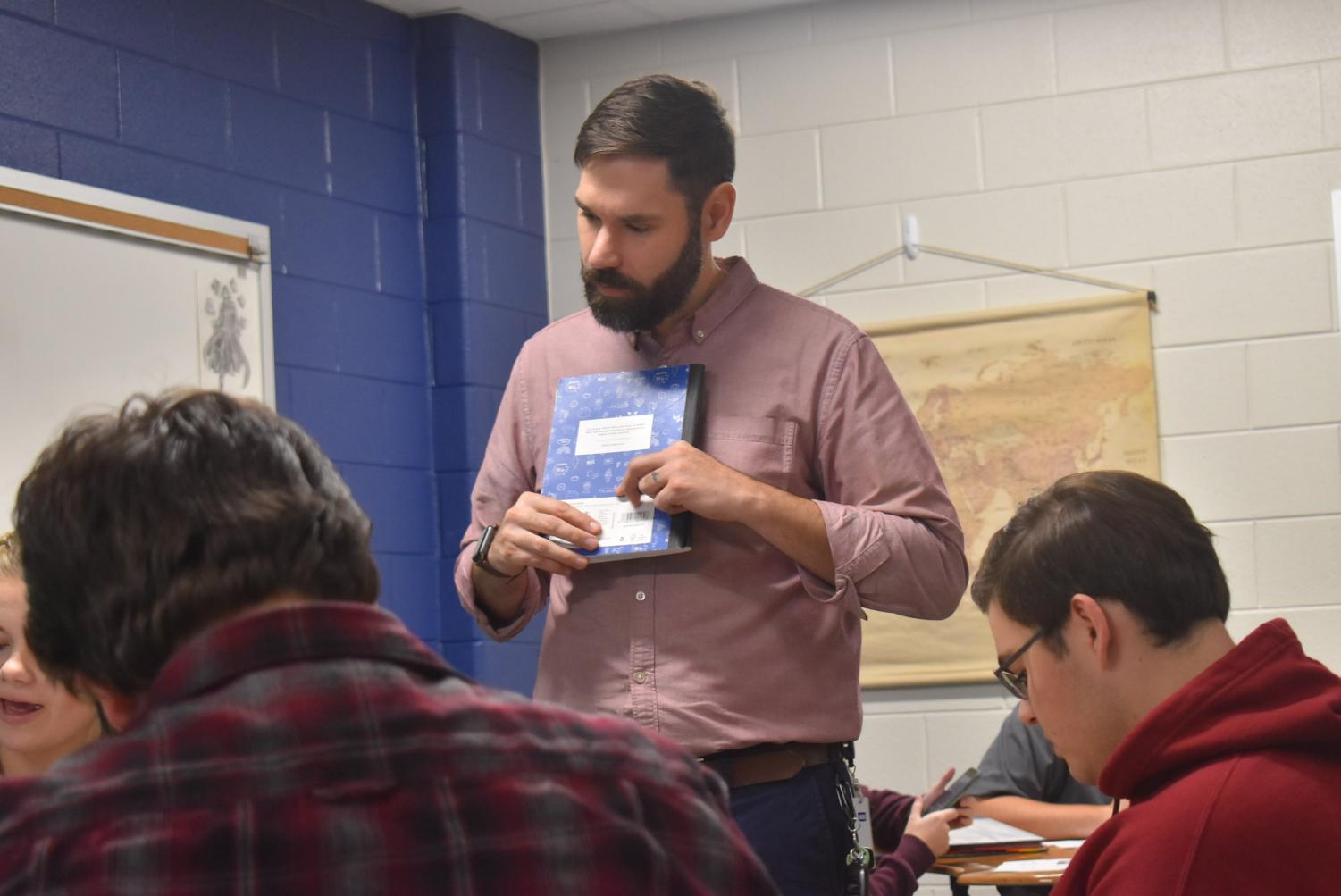 Steven Small is new to Scott County Schools this year and shares his passion for reading with his English students.