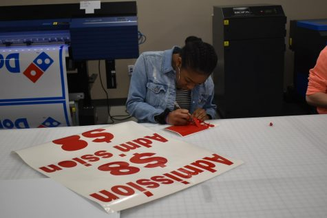 Students in the IT pathway help create signage used throughout the school and community.