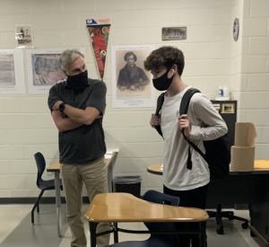 Teacher Todd Kornack and junior Jack Moeller have adapted to wearing masks during the school day.  COVID 19 protocols required mandatory masking in order to make in person learning possible.