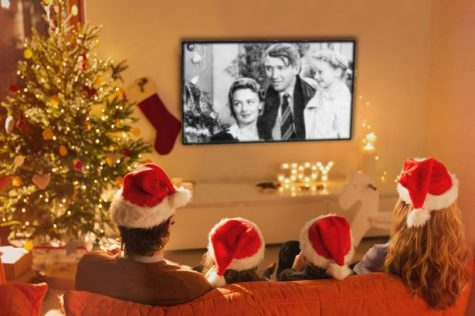 Families can enjoy staying home and watching holiday movies together during the month of December.